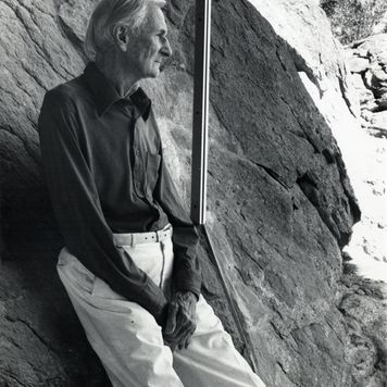 Albert Frey in Frey House 2, leaning against the rock inside the house, Palm Springs, Calif., circa 1995.